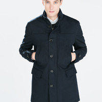 Diagonal navy coat