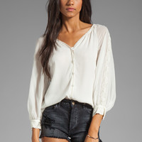 Alice + Olivia Sasha Smocked Cuff Raglan Sleeve Top in Off White from REVOLVEclothing.com