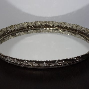 Vintage Hollywood Regency Oval Mirrored Vanity/Dresser Tray with Antiqued White Washed Gold Tone Floral and Feather Metal Filigree Design