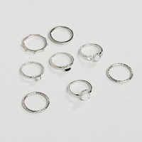 ASOS DESIGN Curve pack of 8 rings with faux moonstone and engraved detail in silver at asos.com