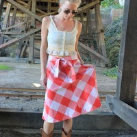 Levi's Vintage 1970s Red and White Gingham Skirt in a size small or medium. It is a country style with a knee length and made of cotton.