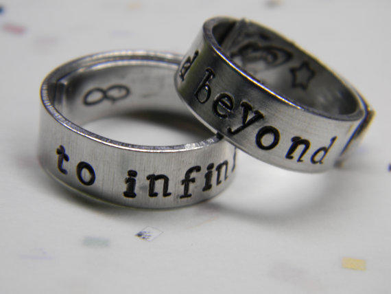 to infinity and beyond two aluminum wrapped style  rings 1/4 inch