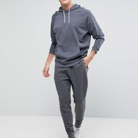 ASOS Tapered Joggers With Zips In Grey at asos.com