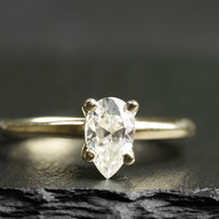 14k pear moissanite ring