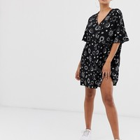 ASOS DESIGN v neck button through mini smock dress in zodiac print | ASOS
