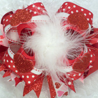 Four Valentine hearts adorn this beautiful Valentines day over the top boutique hair bow with white marabou center