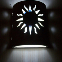 New Sun cutout ceramic wall sconce