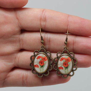 Handmade oval dangling earrings with lacy metal basis and poppy flowers image