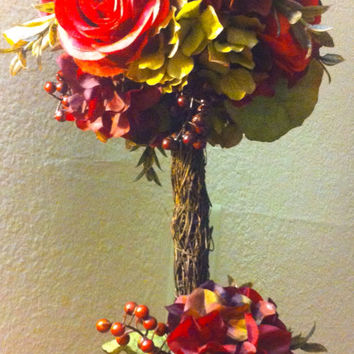 Autumn inspired floral topiary, beautiful hydrangea, roses  fall colors and set in elegant antique vase .