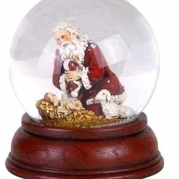 2 Kneeling Santa With Baby Jesus - Snow Globes Feature Santa Claus And A Lamb Lovingly Looking Over Baby Jesus In A Manger