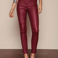 BURGUNDY LEATHERETTE STRETCH ZIP PANTS