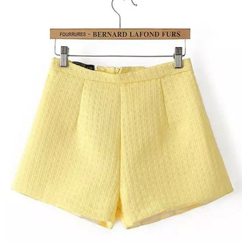 Yellow Textured Mini Shorts