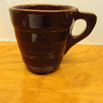 VINTAGE BROWN POTTERY CUP NO NUMBER MADE IN THE USA WITH FLOWER DESIGN COULD BE McCOY