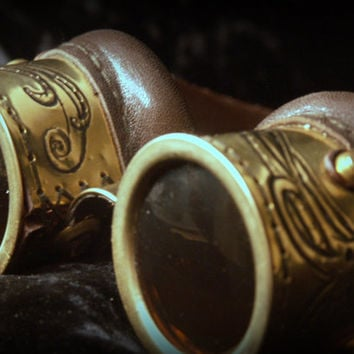 Steampunk goggles in brown leather and brass with embossed octopus and amber lenses.