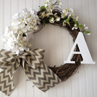 Wreath with white hydrangeas and stem flowers with burlap bow and monogram. summer wreath, wreath for summer. monogram wreath.personalized.