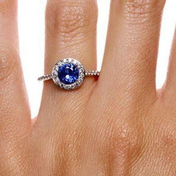 Sapphire Halo Diamond Ring with Side Stones in 18K White Gold
