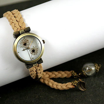 DANDELION wristwatch. Watch with dandelion motif and glass orb with real dandelion seeds. Braided suede with dangling ends.