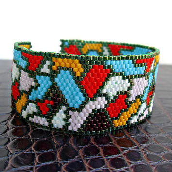 Colorful beaded peyote cuff bracelet making a mosaic design.