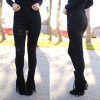 Torn To Pieces Distressed Skinny Jeans in Black