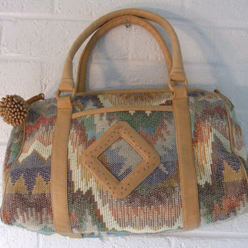 1980s Sharif Woven purse. Stunning abstract Aztec pattern with Leather diamond patch.