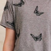 Fly Away With Me Butterfly Crop Top In Gray