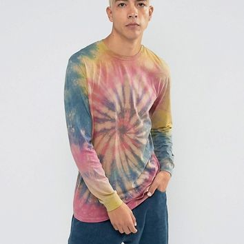 ASOS Longline Long Sleeve T-Shirt With Spiral Tie Dye Wash at asos.com