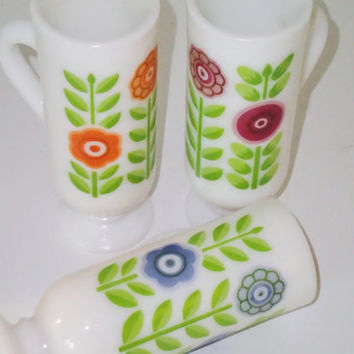 Avon Dutch Treat Demi cups Mod Retro Flower Power embossed print in orange purple and blue on milk glass