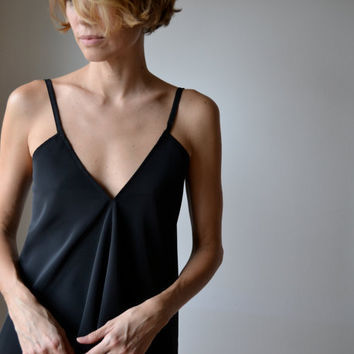 Bias cut, flowing top with  v front and low v back in black synthetic silk, adjustable straps, boho, evening or casual. One size.