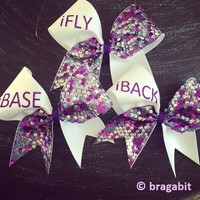 White and sequin fabric with iFly, iBase, iBack etc. IF YOU NEED MORE THAN ONE BOW LEAVE A NOTE WITH WHAT POSITION YOU NEED AND HOW MANY. EXAMPLE: IFLY-5,IBACK- 2, ICOACH - 3 etc