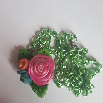 Polymer Clay Roses Pendant on a Pale Green Anodised Aluminium Chain.