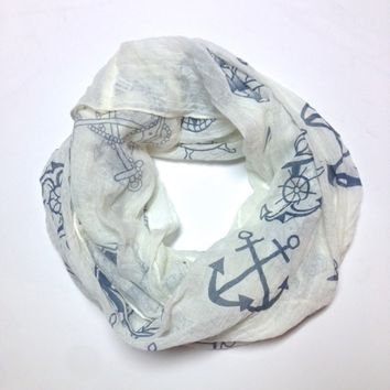 A gauze scarf featuring a nautical themed print like anchors, boats, wheels,anchor with rope on infinity scarf.~ Material:* 70% Viscose* 30% Cotton