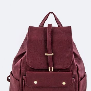 One Sophisticated Backpack Burgundy and Gold detail.