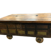 Antique Rustic Chest on wheels COFFEE TABLE Hand carved Eclectic UNique brass and iron front