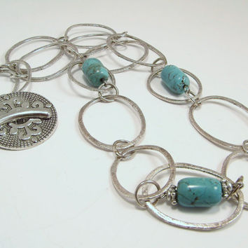 Large Oval Silver Chain and Turquoise Bead Necklace with Ornate Circular Silver Toggle