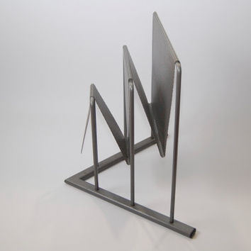 Midcentury 60s magazine rack attributed to Mathieu Matagot for Artimeta