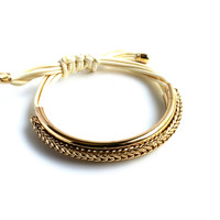"""Tied Up"" Gold And White Faux Leather Bracelet"