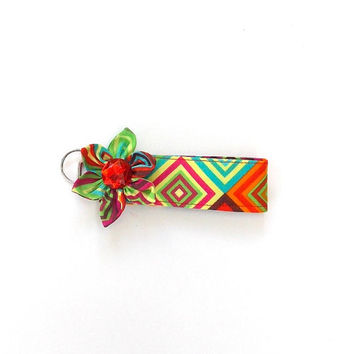 Key Chain, wristlet, Key Fob in Geometric square print with  matching Kanzashi Flower with red  rhinestone center