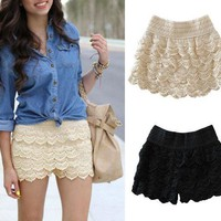 beige or black lace shorts