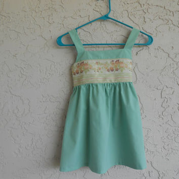 Mackenzie---  Seafoam green reminds us of days at the beach. This casual summer dress is sashed at the back.