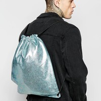 ASOS | ASOS Drawsting Backpack With Oil Slick Effect at ASOS