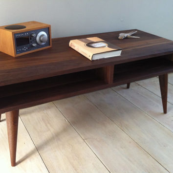 Mid century modern coffee table, black walnut with tapered wood legs.