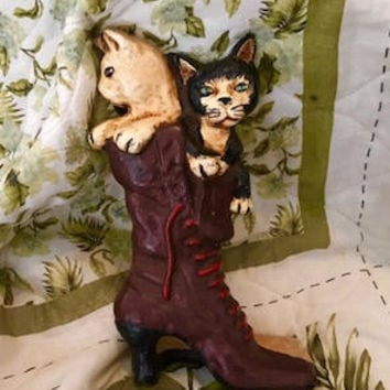 Cute Mid Century Cast Iron Doorstop Featuring a Cat and Dog Peeping Out of a High Heel Brown Boot With Red Shoe Laces. Dog and Cat Doorstop