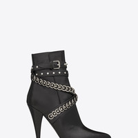 Saint Laurent FETISH 105 Multi Studded Strap Ankle Boot In Black Shiny Leather | ysl.com