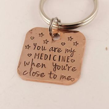 """""""You are my medicine when you're close to me"""" copper keychain"""