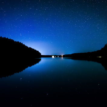 Stars in the night sky reflecting in Echo Lake, at Acadia National Park, Maine.