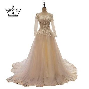 Luxury Pearls Embroidery Long Sleeve Wedding Dresses 2017 Sexy Sheer Backless Bridal Gowns Dubai Arabic Vestido De Noiva