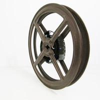 Vintage Film Reel: Brown Metal with Film Remnant