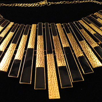 VINTAGE Egyptian Revival bib collar Necklace with hammered gold tone spikes accented with black  enamel