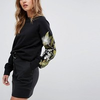 Weekday Sweatshirt with Floral Embroidary Arm at asos.com