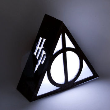 Ambient light of Deathly Hallows from Harry Potter. Decoration lamp, home decor, illumination, wood. Book, movie, magician. Death reliques.